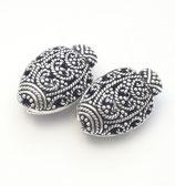 Ovale, geschwärzte und verzierte Perle 22 mm