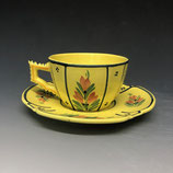 Whimper yellow cup and saucer