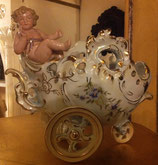 CARROZZA CON PUTTO