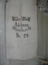 Shabby alter Mehlsack mit dekorativem Aufdruck