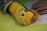 Handschuh als Griffhilfe