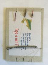 Tippsatz mit handgebundenen Angeln, und einer für den Fisch unwiderstehlichen Fliege.