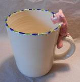 Tasse mit Henkelhocker Schweinchen