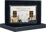 Sektflasche und Gläser mit zwei Goldbarren ab 0,10 Gramm M5G2