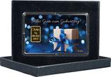 Geschenk mit blauem Band mit einem Goldbarren ab 0,50 Gramm M7G1
