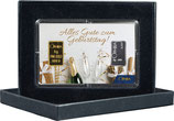 Sektflasche und Gläser mit einem Goldbarren ab 0,10 Gramm und einem Silberbarren ab 1 Gramm M5GS
