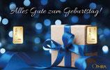 Geschenk mit blauem Band und zwei Goldbarren ab 0,10 Gramm M7G2