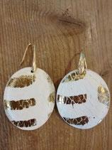 White and golden earring