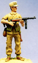 MOD S-53 standing, machine pistol at ready, in soft cap