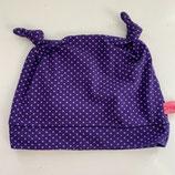 lila Punkte auf violett