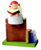 Schutzengel auf Buch, lesend