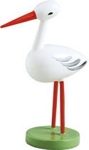Storch, klein, auf zwei Beinen