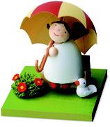 Schutzengel mit Schirm auf Bank