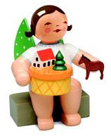 Engel mit Spielzeugdorf
