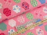 Sechsecke Baumwolldruck auf rosa Tupfen