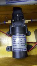 bomba de alta presión con salida y entrada de 6mm y conexion.