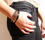 Bracelet bangle or et cuir noir brillant