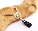 """sautoir """"Gipsy"""", cercle fleur filigrane plaqué argent, pompon franges de cuir noir et or"""