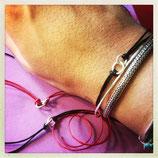 braccialetto con due anelli in argento incastrati