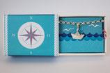 Sammelarmband mit Anhänger Schiffchen mit blauem Segel