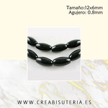 Abalorio cristal oval alargado negro 12x6mm ABAL-Cristal P27 ( tira de 29 abalorios aprox)