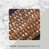 Abalorios -  Cristal facetado  4x3mm color dorado semitransparente brillo  P4Y5A (140 piezas)