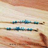 Producto acabado - Cordón para mascarilla modelo cadena dorada y estrella de mar azul, abalorios y perlas