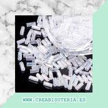 Abalorios -  Cristal de colores, canutillo torcido blanco traslúcido arcoiris    20gr CAN002