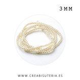 Abalorio cristal perla diminuta  sintética color beis muy claro casi blanco (270 un. aproximadamente) 3x3mm P3MM