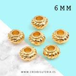 Entrepieza dorada - DO1- x - disco  dorado flor 6x4,4mm C65 (50 piezas aprox)