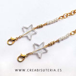 Producto acabado - Cordón para mascarilla modelo cadena dorada y estrella traslúcida purpurina  blanca
