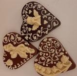 Schokoladenherz Vollmilch verziert mit  Ornamenten aus weißer Schokolade