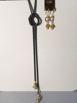 Black Steel Necklace with pearl and gold nest pendants that dangle from the ends.