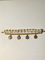 Triple strand of Pearls, Gold Chain and Gold chain with crystals.  Has 4 two toned medals dangling.