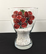 Vase mit Orchideen rot