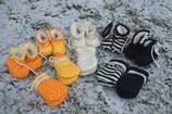 Liebevoll handgefertigte Babyhandschuhe von PlüNatur