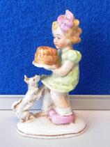 Mädchen mit Hund und Kuchen