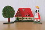 Farmhaus mit Frau und Baum