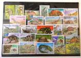 Einsteckfolie mit 25 ausländischen Briefmarken - Urzeittiere