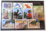 Einsteckfolie mit 11 ausländischen Briefmarken - Urzeittiere