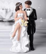 Sposi eleganti lei seduta