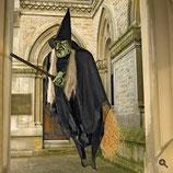 Réplica de bruja volando con su escoba para decorar Halloween