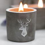 Kerze in Betontopf