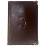 Porte-cartes / papiers Cartier en cuir bordeaux et bordures en métal doré