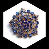 Broche ronde métal doré à strass bleus BRO041.