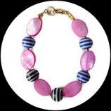 Bracelet enfant palets roses, perles spirales fait main, modéle unique.