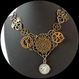 Collier steampunk montre, dragons, lunette engrenages. Bijou style steampunk fait main.
