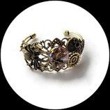 Bracelet style steampunk fait main araignée, cabochon verre, engrenages.