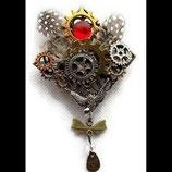 broche steampunk engrenages et hirondelle artisanale