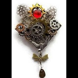 Broche steampunk engrenages et hirondelle faite main